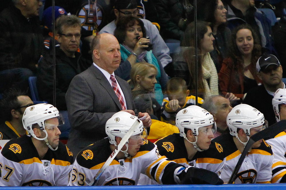 Mar. 31, 2012; Uniondale, NY, USA; Boston Bruins head coach Claude Julien behind the bench during the second period against the New York Islanders at Nassau Veterans Memorial Coliseum. Mandatory Credit: Debby Wong-US PRESSWIRE