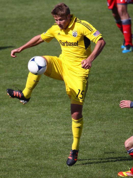Mar 31, 2012; Toronto, ON, Canada; Columbus Crew midfielder Kirk Urso (15) plays the ball against the Toronto FC at BMO Field. The Crew beat the FC 1-0. Mandatory Credit: Tom Szczerbowski-US PRESSWIRE