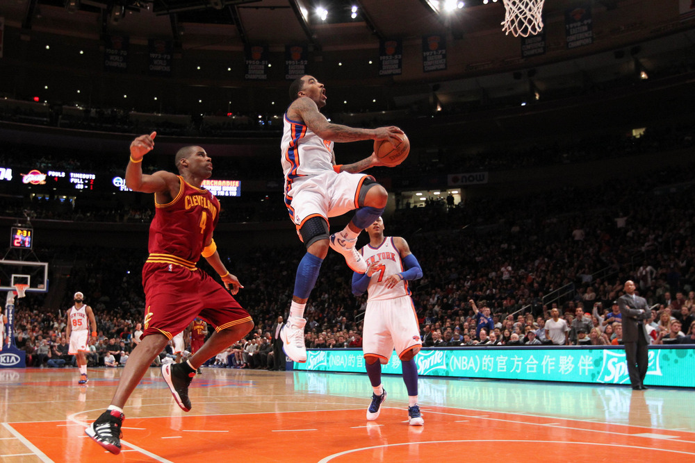 Mar 31, 2012; New York, NY, USA;  New York Knicks shooting guard J.R. Smith (8) drives up to score during the fourth quarter against the Cleveland Cavaliers at Madison Square Garden.  Knicks won 91-75.  Mandatory Credit: Anthony Gruppuso-US PRESSWIRE