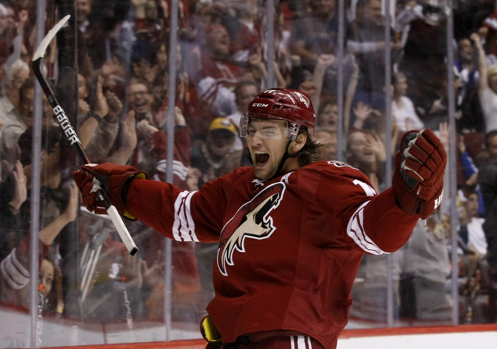 March 31, 2012; Glendale, AZ, USA; Phoenix Coyotes center Martin Hanzal (11) celebrates after his team takes a 4-0 lead in the third period against the Anaheim Ducks at Jobing.com.  Mandatory Credit: Rick Scuteri-US PRESSWIRE
