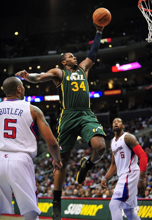 March 31, 2012; Los Angeles, CA, USA; Utah Jazz small forward C.J. Miles (34) dunks to score a basket against the Los Angeles Clippers during the second half at Staples Center. Mandatory Credit: Gary A. Vasquez-US PRESSWIRE