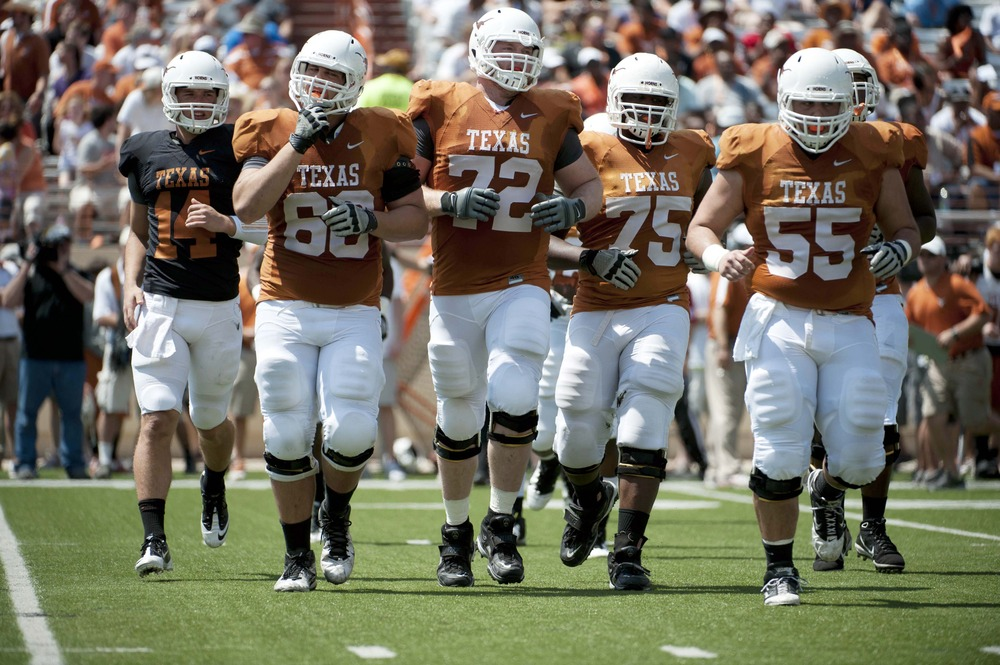 Apr 1, 2012; Austin, TX, USA; Texas Longhorns offensive players take the field during the first half of the spring game at Texas-Memorial Stadium. Mandatory Credit: Brendan Maloney-US PRESSWIRE