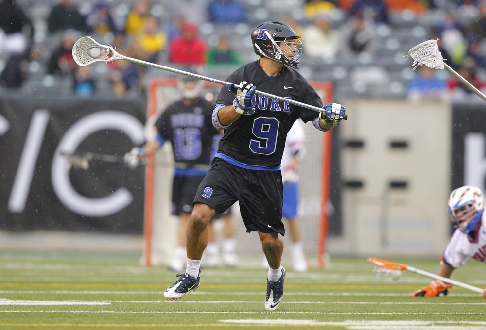 Apr 1, 2012; East Rutherford, NJ, USA;  Duke Blue Devils long stick midfielder CJ Costabile (9) during the second quarter against the Syracuse Orange at the Big City Classic at MetLife Stadium. Mandatory Credit: Jim O'Connor-US PRESSWIRE