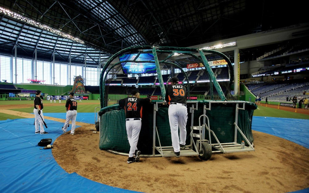 April 1, 2012; Miami, FL, USA;  Miami Marlins batting coach Eduardo Perez (30) and his father Tony Perez (24) watch batting practice before a game against the New York Yankees at Marlins Park. Mandatory Credit: Robert Mayer-US PRESSWIRE