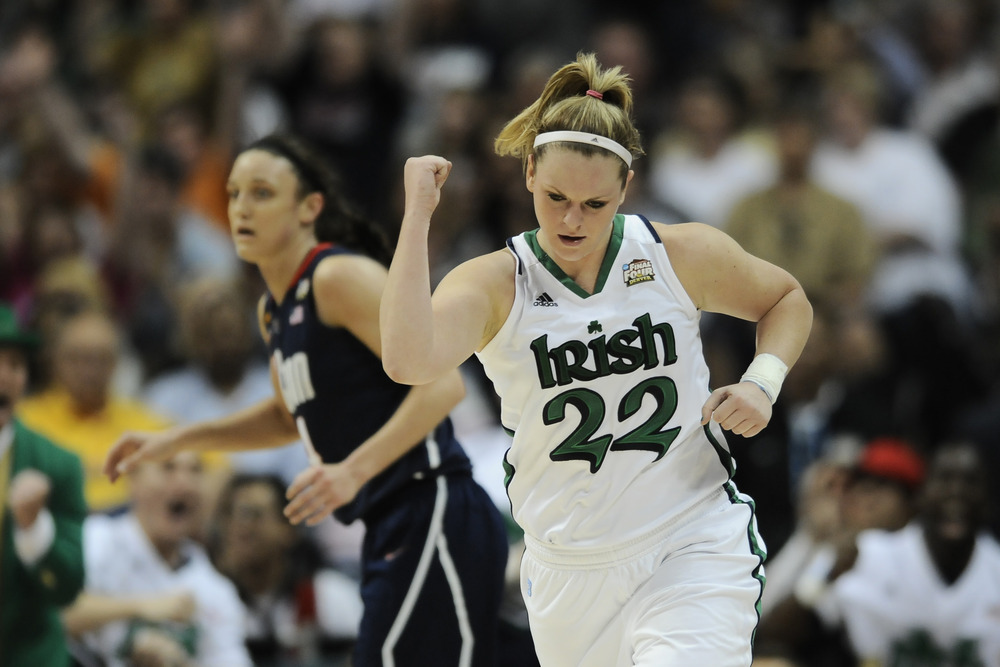 Brittany Mallory celebrates after a play in front of Kelly Faris during Notre Dame's overtime win. (Credit: Ron Chenoy-US PRESSWIRE)