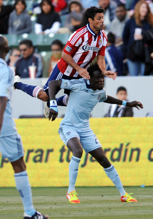 Apr 1, 2012; Carson, CA, USA; Chivas USA defenseman Ante Jazic (13) jumps on top of Sporting Kansas City forward Kei Kamara (23) while going up for a header during the first half at the Home Depot Center. Mandatory Credit: Kelvin Kuo-US PRESSWIRE