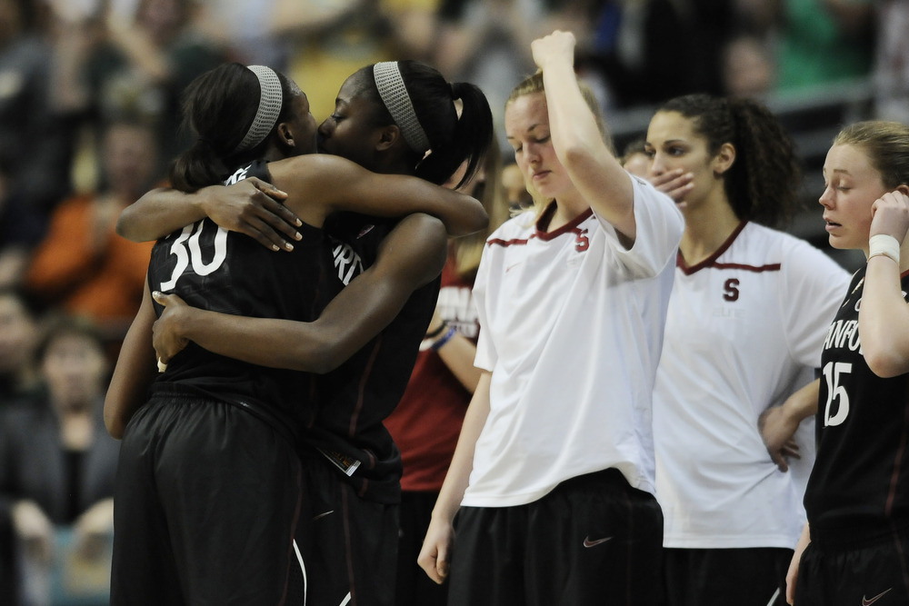One last basketball embrace for the Ogwumike sisters after the Baylor Bears knocked the Stanford Cardinal out in the Final Four. (Credit: Ron Chenoy-US PRESSWIRE)