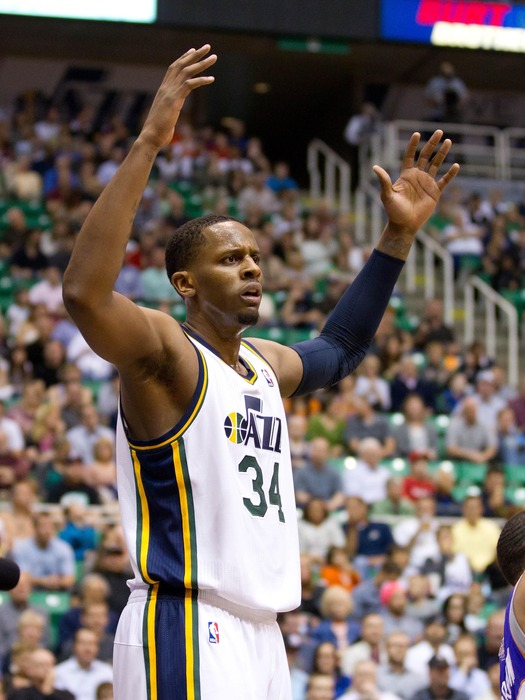 April 4, 2012; Salt Lake City, UT, USA; Utah Jazz small forward C.J. Miles (34) reacts to having a foul called against him during the first quarter against the Phoenix Suns at Energy Solutions Arena. Mandatory Credit: Russ Isabella-US PRESSWIRE