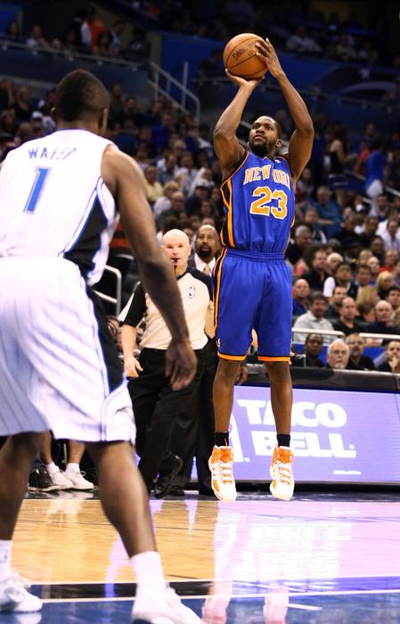 Apr 5, 2012; Orlando, FL, USA; New York Knicks point guard Toney Douglas (23) attempts a jump shot against the Orlando Magic during the second quarter at Amway Center. Mandatory Credit: Douglas Jones-US PRESSWIRE