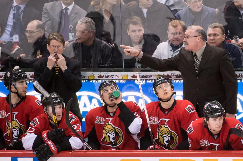 Apr 5, 2012; Ottawa, ON, CAN;  Ottawa Senators coach Paul MacLean (right) really hates it when assistant coach Mark Reeds whistles. Mandatory Credit: Marc DesRosiers-US PRESSWIRE
