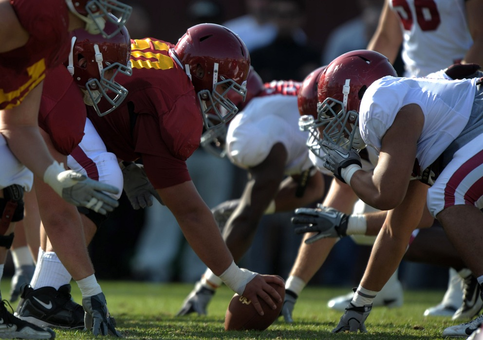 Apr 5, 2012; Los Angeles, CA, USA; General view of the line of scrimmage as Southern California Trojans center Khaled Holmes (78) snaps the ball during a spring practice at Howard Jones Field. Mandatory Credit: Kirby Lee/Image of Sport-US PRESSWIRE