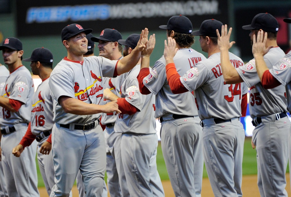 Apr 6, 2012; Milwaukee, WI, USA;  St. Louis Cardinals left fielder Matt Holliday (7) greets players during opening day introductions before game against the Milwaukee Brewers at Miller Park.  Mandatory Credit: Benny Sieu-US PRESSWIRE