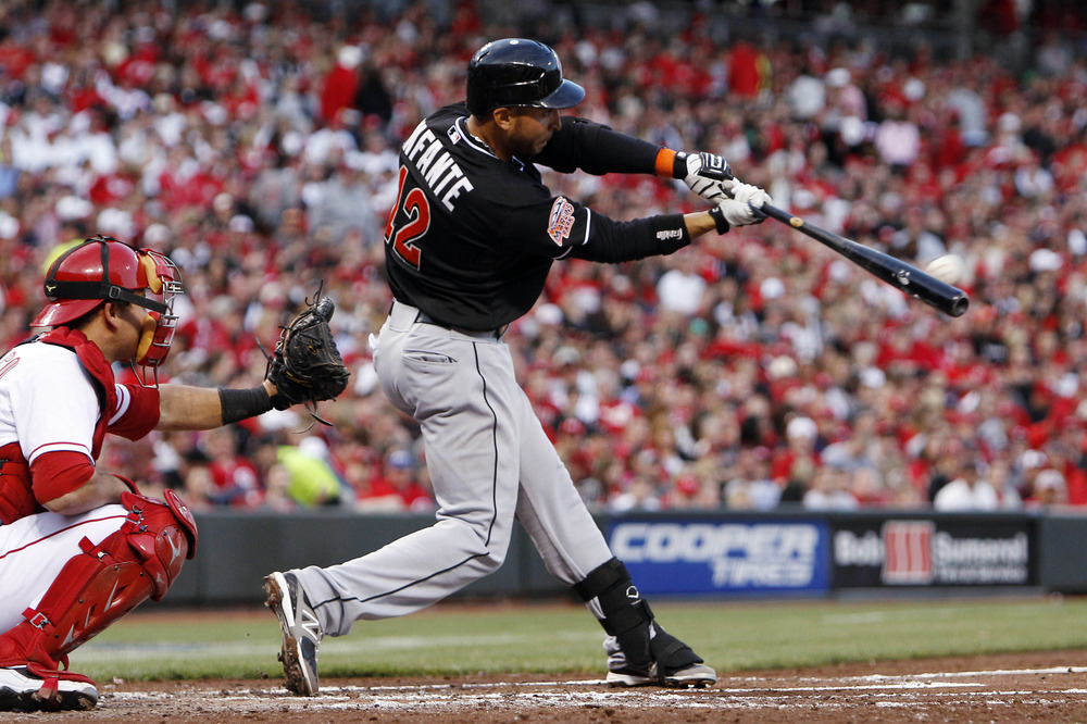 Apr 7, 2012; Cincinnati, OH, USA; Miami Marlins second baseman Omar Infante (12) hits a double in the third inning against the Cincinnati Reds at Great American Ballpark. Mandatory Credit: Frank Victores-US PRESSWIRE