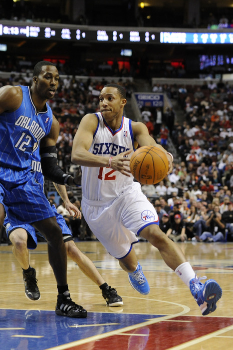 Apr 07, 2012; Philadelphia, PA, USA; Philadelphia 76ers guard Evan Turner (12) is defended by Orlando Magic center Dwight Howard (12) during the first quarter at the Wells Fargo Center. Mandatory Credit: Howard Smith-US PRESSWIRE