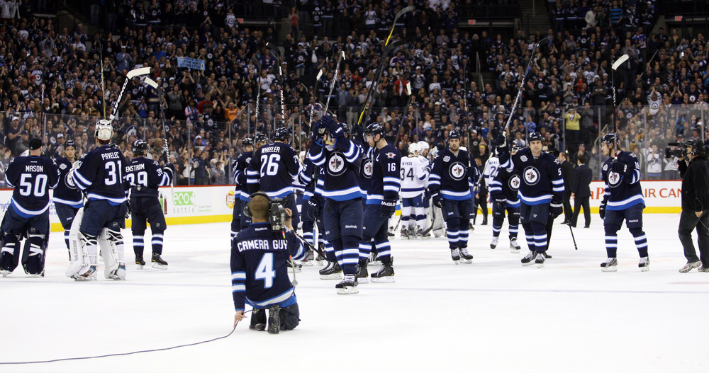 April 7, 2012; Winnipeg, MB, CAN; Winnipeg Jets thank their fans after their final game of the season against the Tampa Bay Lightning at the MTS Centre. Tampa Bay wins 4-3. Mandatory Credit: Bruce Fedyck-US PRESSWIRE