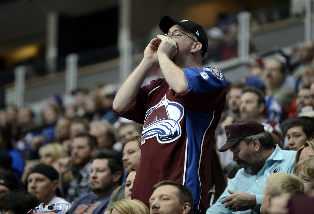 April 7 2012; Denver, CO, USA; Colorado Avalanche fan calls out to the players during the second period against the Nashville Predators of the game at the Pepsi Center. Mandatory Credit: Ron Chenoy-US PRESSWIRE