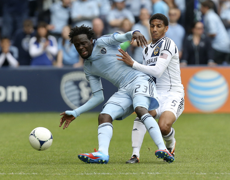KANSAS CITY, KS - APRIL 7:   Kei Kamara #23 of the Sporting Kansas City and Sean Franklin #5 of the Los Angeles Galaxy battle for the ball  at Livestrong Sporting Park on April 7, 2012 in Kansas City, Kansas. (Photo by Ed Zurga/Getty Images)