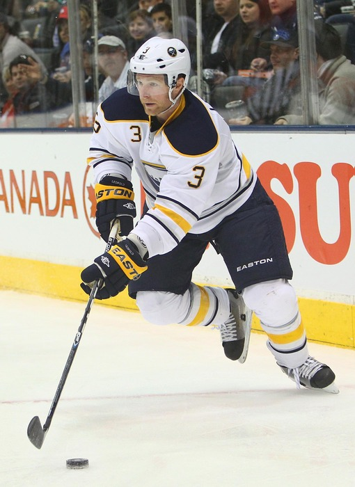 Mar 31, 2012; Toronto, ON, Canada; Buffalo Sabres defenseman Jordan Leopold (3) skates out with the puck against the Toronto Maple Leafs at the Air Canada Centre. The Maple Leafs beat the Sabres 4-3. Mandatory Credit: Tom Szczerbowski-US PRESSWIRE