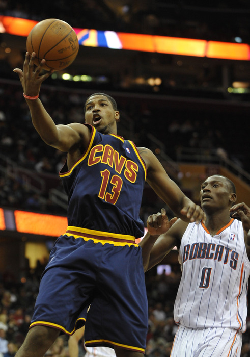Apr 10, 2012; Cleveland, OH, USA; Cleveland Cavaliers forward Tristan Thompson (13) grabs a rebound in front of Charlotte Bobcats center Bismack Biyombo (0) in the second quarter at Quicken Loans Arena. Mandatory Credit: David Richard-US PRESSWIRE