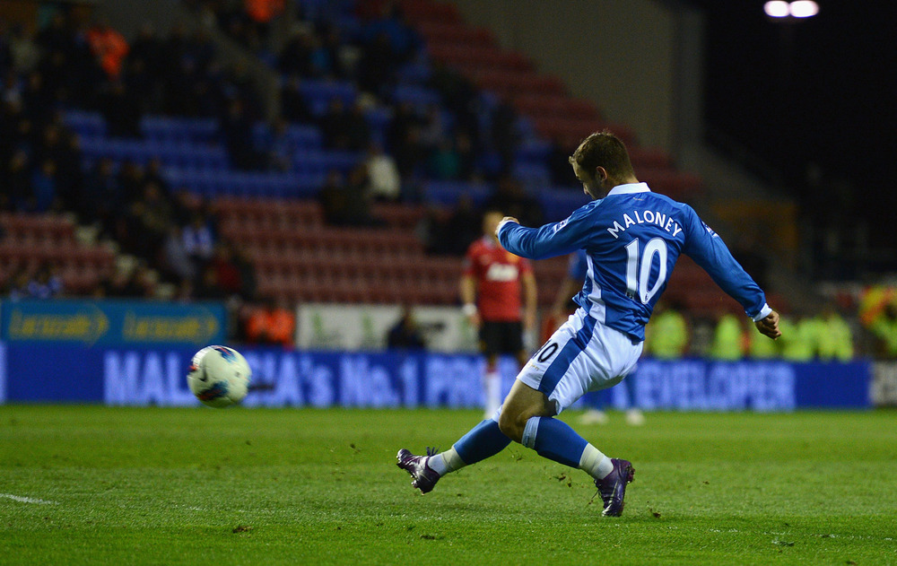 Shaun Maloney of Wigan scores to make it 1-0  during the Barclays Premier League match between Wigan Athletic and Manchester United at the DW Stadium.