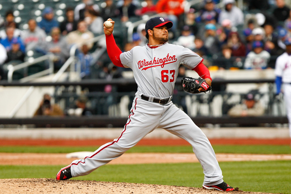 Apr. 11, 2012; Flushing, NY, USA; Washington Nationals relief pitcher Henry Rodriguez (63) pitches during the ninth inning against the New York Mets at Citi Field. Nationals won 4-0. Mandatory Credit: Debby Wong-US PRESSWIRE