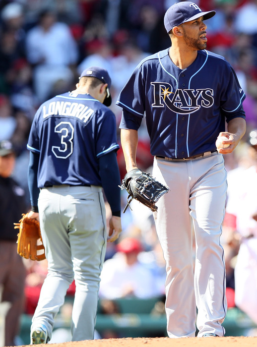 BOSTON, MA - APRIL 13:  David Price #14 of the Tampa Bay Rays struggles in the third inning against the Boston Red Sox during the home opener on April 13, 2012 at Fenway Park in Boston, Massachusetts.  (Photo by Elsa/Getty Images)