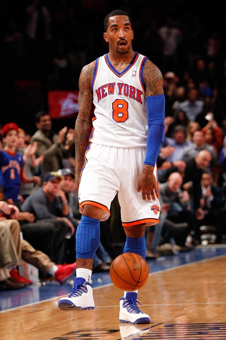 Apr. 13, 2012; New York, NY, USA; New York Knicks shooting guard J.R. Smith (8) dribbles the ball during the second half against the Washington Wizards at Madison Square Garden. Knicks won 103-65. Mandatory Credit: Debby Wong-US PRESSWIRE