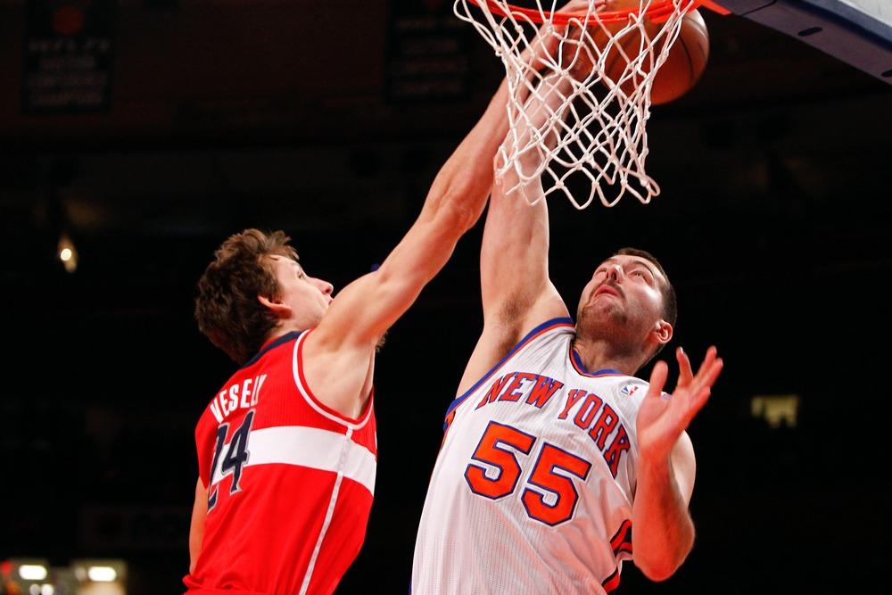 Apr. 13, 2012; New York, NY, USA; Washington Wizards forward Jan Vesely (24) fouls New York Knicks forward Josh Harrellson (55) during the second half at Madison Square Garden. Knicks won 103-65. Mandatory Credit: Debby Wong-US PRESSWIRE