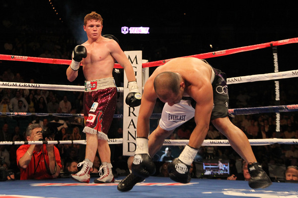LAS VEGAS - MAY 01:  (L-R) Saul Alvarez of Mexico knocks down Jose Miguel Cotto of Puerto Rico during the welterweight fight at the MGM Grand Garden Arena on May 1, 2010 in Las Vegas, Nevada.  (Photo by Jed Jacobsohn/Getty Images)