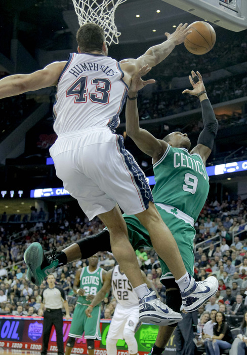 Apr 14, 2012; Newark, NJ, USA;  Boston Celtics point guard Rajon Rondo (9) has shot rejected by New Jersey Nets power forward Kris Humphries (43) as he drives to the basket at the Prudential Center. Mandatory Credit: Jim O'Connor-US PRESSWIRE