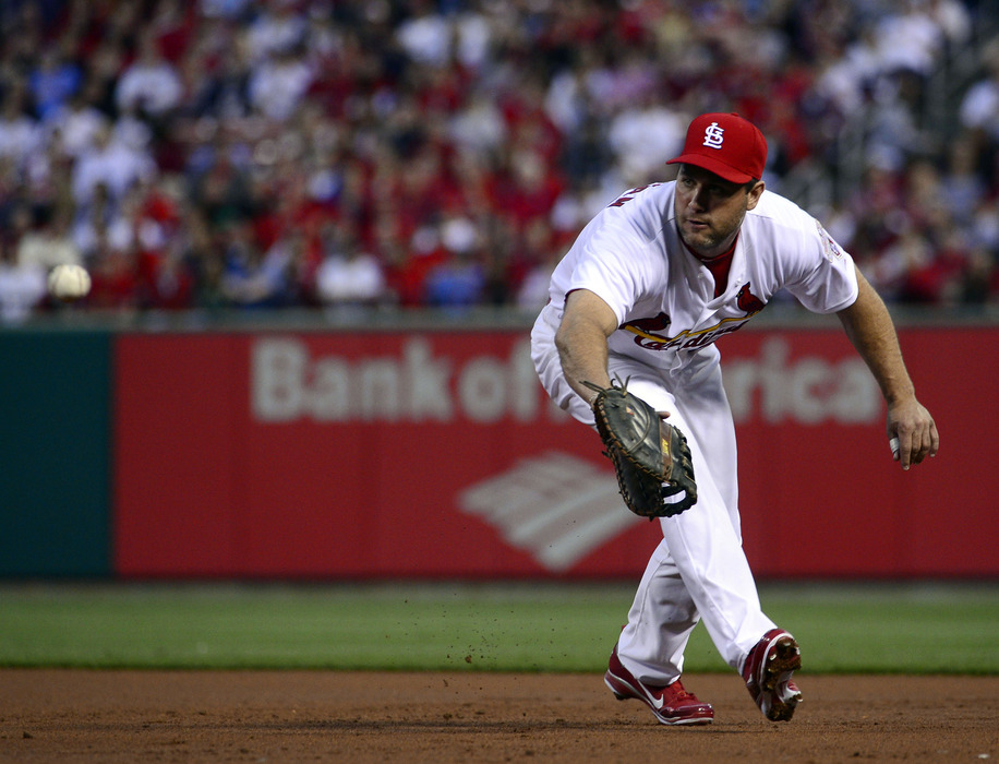 April 17, 2012; St. Louis, MO, USA; St. Louis Cardinals first baseman Lance Berkman (12) makes a play against the Cincinnati Reds during the game at Busch Stadium in St. Louis, MO. Mandatory Credit: Scott Rovak-US PRESSWIRE