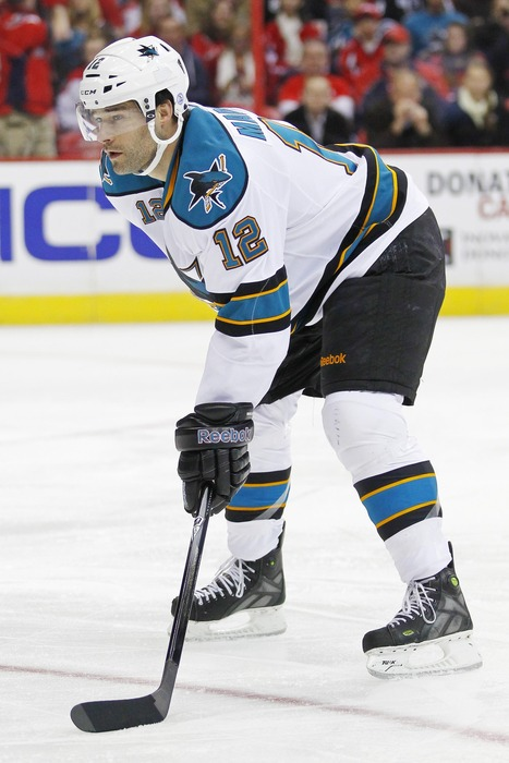 February 13, 2012; Washington, DC, USA; San Jose Sharks left wing Patrick Marleau (12) lines up for a face-off against the Washington Capitals at Verizon Center. Mandatory Credit: Geoff Burke-US PRESSWIRE