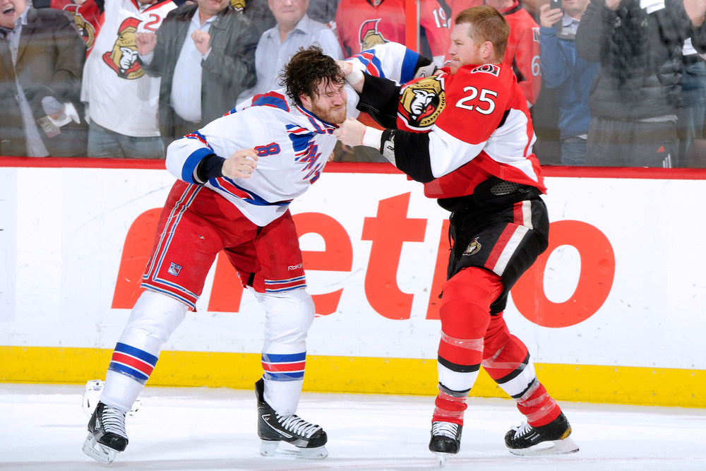 Chris Neil tried to do it all on Monday.  (Photo by Richard Wolowicz/Getty Images)