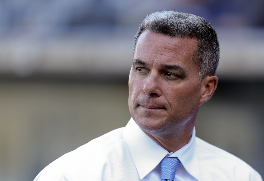 KANSAS CITY, MO - APRIL 23:  Dayton Moore general manager of the Kansas City Royals watches batting practice before a game against the Toronto Blue Jays at Kauffman Stadium April 23, 2012 in Kansas City, Missouri. (Photo by Ed Zurga/Getty Images)