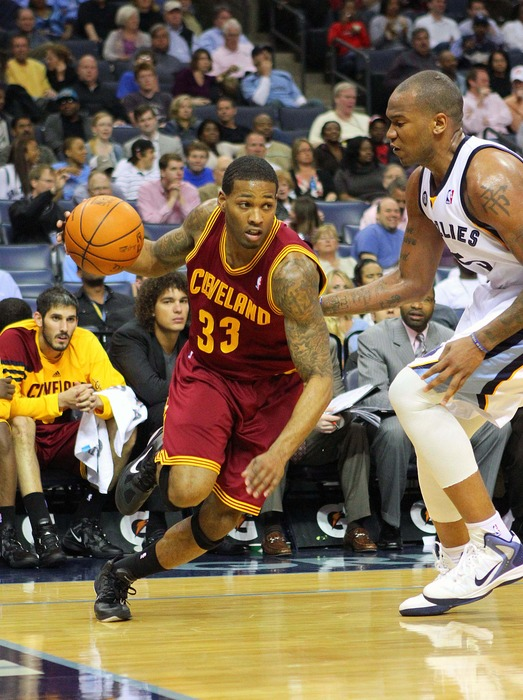 Apr 23, 2012; Memphis, TN, USA;  Cleveland Cavaliers small forward Alonzo Gee (33) drives to the basket against Memphis Grizzlies center Marreese Speights (5) during the first half at the FedEx Forum.  Mandatory Credit: Spruce Derden-US PRESSWIRE