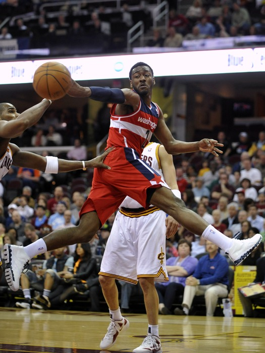 Apr 25, 2012; Cleveland, OH, USA;  Washington Wizards point guard John Wall (2) passes through the lane against the Cleveland Cavaliers in the first quarter at Quicken Loans Arena. Mandatory Credit: David Richard-US PRESSWIRE