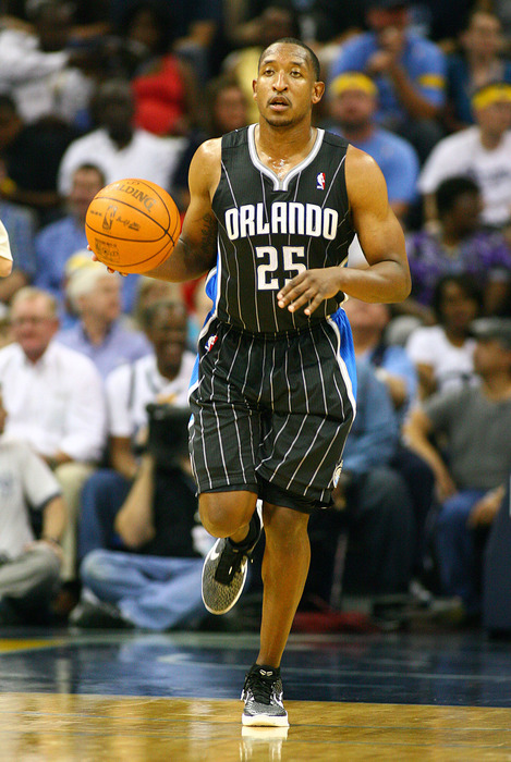 Apr 26, 2012; Memphis, TN, USA;  Orlando Magic point guard Chris Duhon (25) dribbles the ball up the court during the first against the Memphis Grizzlies half at the FedEx Forum.  Mandatory Credit: Spruce Derden-US PRESSWIRE