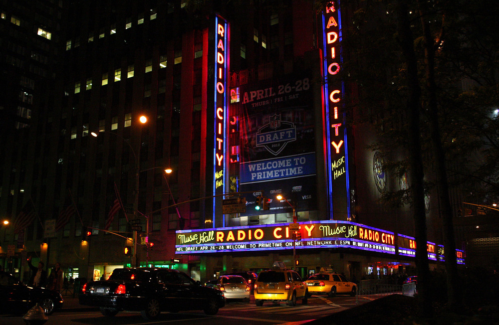 A general exterior view of Radio City Music Hall as taxi cabs and cars drive by following the first round of the 2012 NFL Draft at Radio City Music Hall on April 26, 2012 in New York City.  (Photo by Chris Chambers/Getty Images)