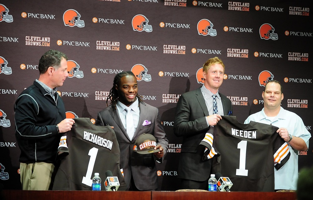 April 27, 2012; Berea, OH, USA; Trent Richardson and Brandon Weeden pose with jerseys at a press conference after being selected in the 2012 NFL Draft at the Cleveland Browns training facility. Mandatory Credit: Andrew Weber-US PRESSWIRE