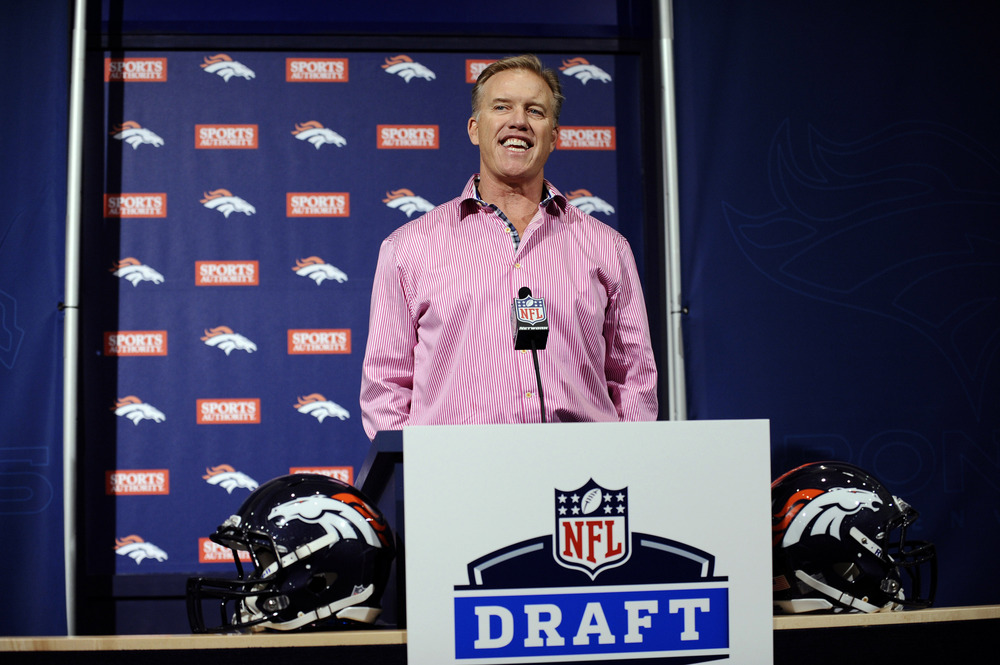 April 28 2012; Englewood, CO, USA; Denver Broncos executive vice president of football operations John Elway speaks to the media before his draft picks are introduced to the media at Broncos headquarters. Mandatory Credit: Ron Chenoy-US PRESSWIRE