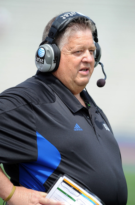Apr 28, 2012; Lawrence, KS, USA; Kansas Jayhawks head coach Charlie Weis watches during the second half of the Spring Game at Memorial Stadium. Mandatory Credit: John Rieger-US PRESSWIRE