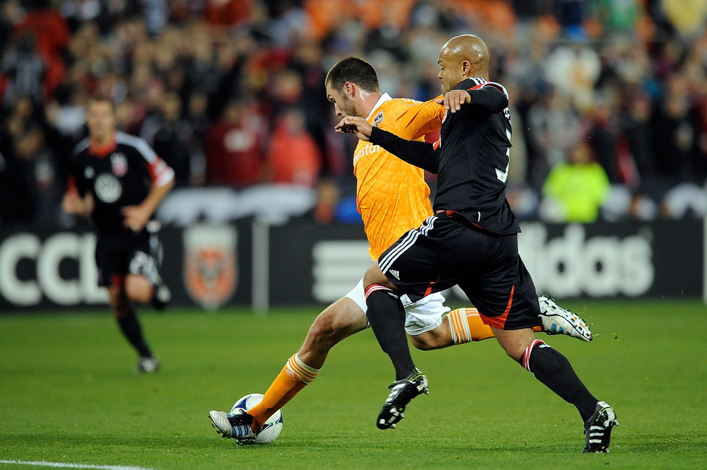 WASHINGTON, DC - APRIL 28:  Robbie Russell #3 of D.C. United battles with Will Bruin #12 of the Houston Dynamo at RFK Stadium on April 28, 2012 in Washington, DC.  (Photo by Patrick McDermott/Getty Images)
