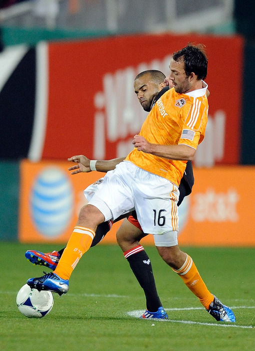 WASHINGTON, DC - APRIL 28:  Maicon Santos #29 of D.C. United battles for the ball against Adam Moffat #16 of the Houston Dynamo during a game at RFK Stadium on April 28, 2012 in Washington, DC.  (Photo by Patrick McDermott/Getty Images)