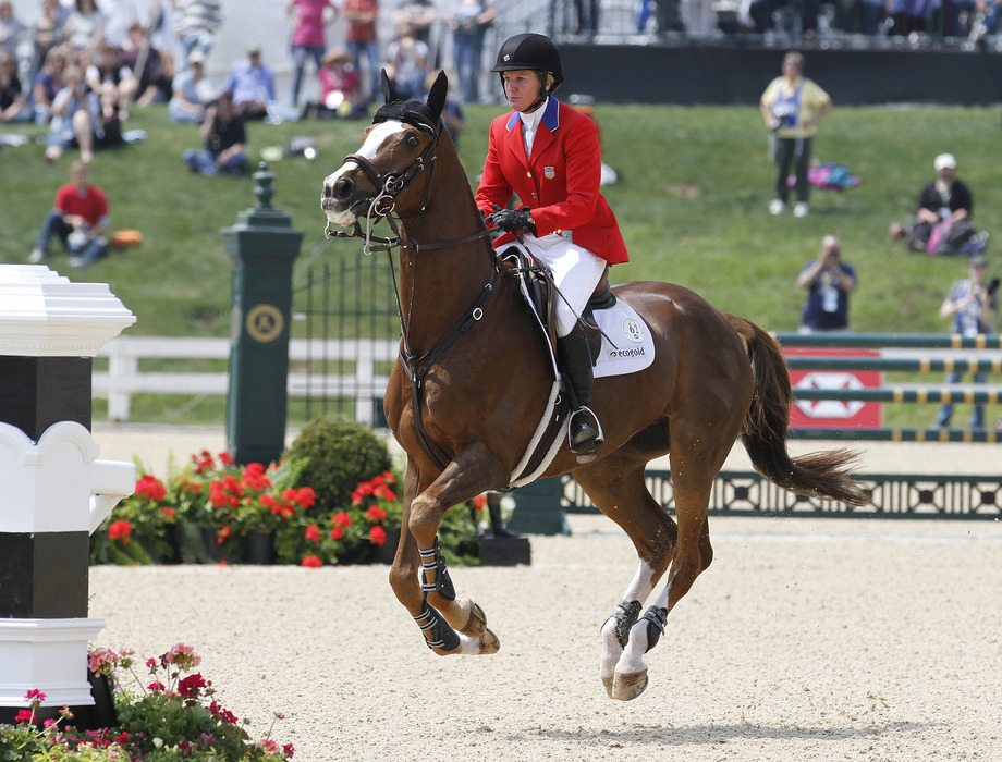 Apr 29, 2012; Lexington, KY, USA; Karen O'Connor aboard Mr Medicott (62) competes in the Jumping event at the Rolex Three-Day Event at the Kentucky Horse Park. Mandatory Credit: Mark Zerof-US PRESSWIRE