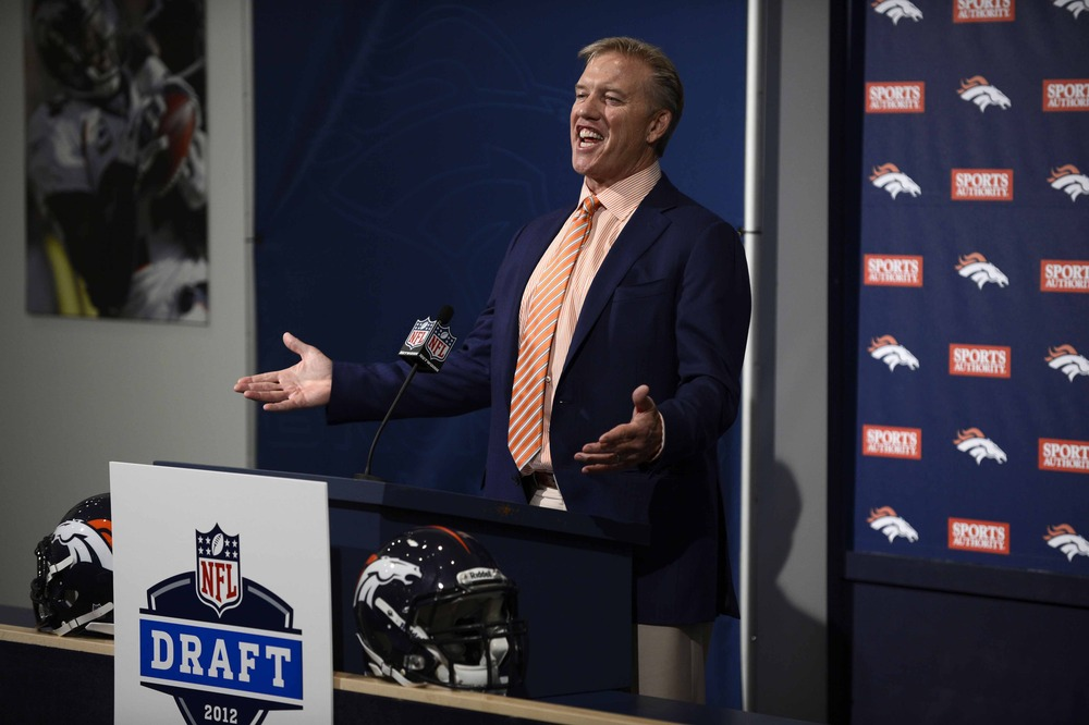April 26 2012; Englewood, CO, USA; Denver Broncos executive vice president of football operations John Elway speaks following the end of the first round of the NFL Draft at Broncos headquarters. Mandatory Credit: Ron Chenoy-US PRESSWIRE