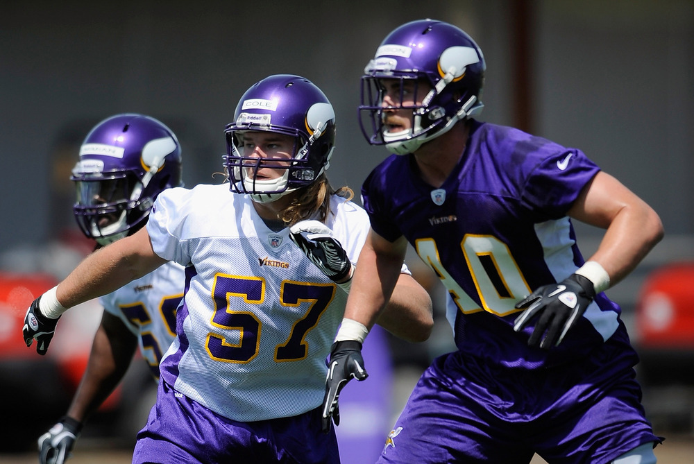 EDEN PRAIRIE, MN - MAY 4: Audie Cole #57 and Rhett Ellison #40 of the Minnesota Vikings run through a drill during a rookie minicamp on May 4, 2012 at Winter Park in Eden Prairie, Minnesota. (Photo by Hannah Foslien/Getty Images)