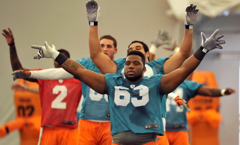 May 4, 2012; Davie, FL, USA; Miami Dolphins guard Derek Dennis (63) during drills at rookie mini-camp practice at the Dolphins training facility. Mandatory Credit: Steve Mitchell-US PRESSWIRE