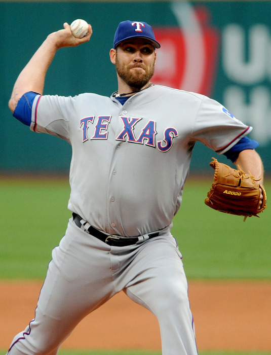 May 4, 2012; Cleveland, OH, USA: Texas Rangers starting pitcher Colby Lewis (48) throws a pitch during the first inning against the Cleveland Indians at Progressive Field.  Mandatory Credit: Eric P. Mull-USPRESSWIRE