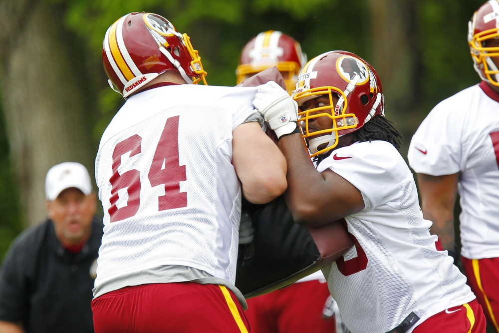 May 6, 2012; Ashburn, VA, USA; Washington Redskins offensive takle Mark Huyge (64) and Redskins offensive guard Adam Gettis (73) participate in drills during rookie minicamp at Redskins Park. Mandatory Credit: Geoff Burke-US PRESSWIRE