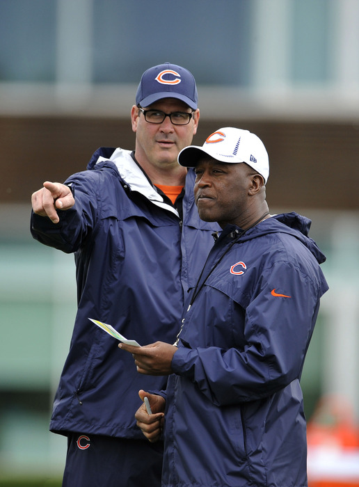 LAKE FOREST, IL - MAY 12:  Head coach Lovie Smith (R) and offensive coordinator Mike Tice of the Chicago Bears talk during rookie minicamp at Halas Hall on May 12, 2012 in Chicago, Illinois.  (Photo by Brian Kersey/Getty Images)